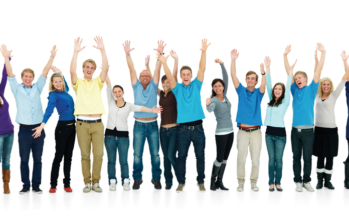 Full length portrait of happy men and women with hands raised against white background